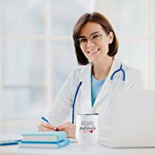 woman doctor at work with a fancyfams stainless steel because patients tumbler filled with coffee