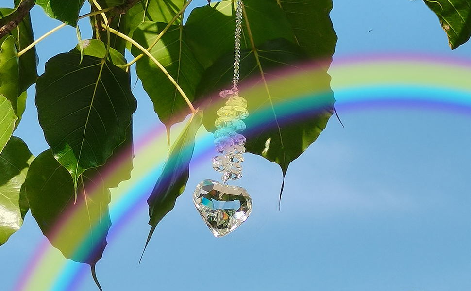 The heart crystal pendant refracts sunlight into a beautiful rainbow