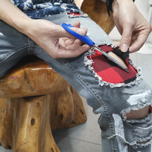 how to repair ripped jeans holes
