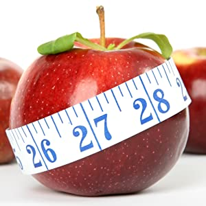 A red apple with measuring tape wrapped around the middle