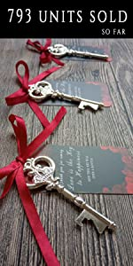 black tags with rose printing and silver key bottle opener wedding favor, red ribbon
