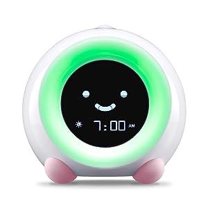 Blush Pink MELLA Sleep Trainer on Wake Mode with Green Light