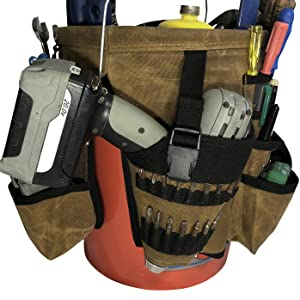 drill machine and different tools in the pocket of organizer