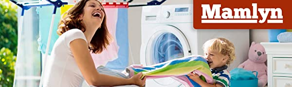 Mother showing child how to turn knobs on washing machine with red Mamlyn logo in top right corner