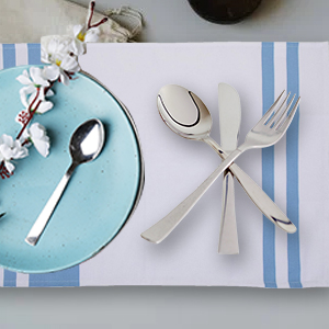 on dining table blue kitchen sack towel with cutlery