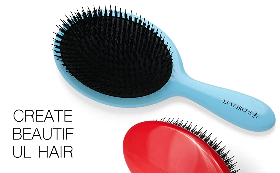 an image of two LUVCIRCUS 001 hairbrushes. ONE IN BLUE AND ONE IN RED.