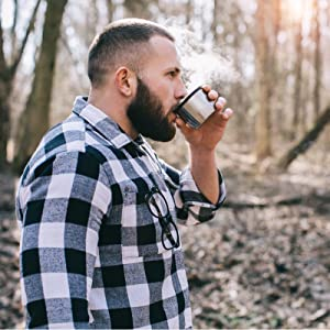 Man drinking rum coffee in the woods