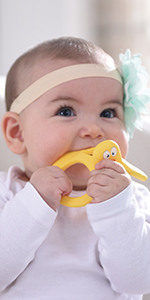 Mombella yellow duck silicone teether toy and pacifier soother
