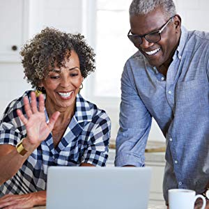 Couple doing a video call through their laptop