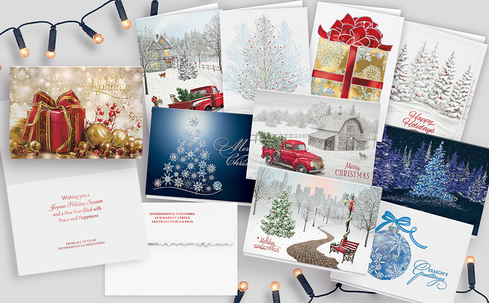 Display of 10 unique Christmas holiday cards, a card inside, and an envelope with return addressing.