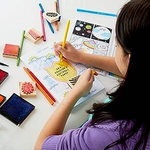 girl using comic book kit arts and crafts kit