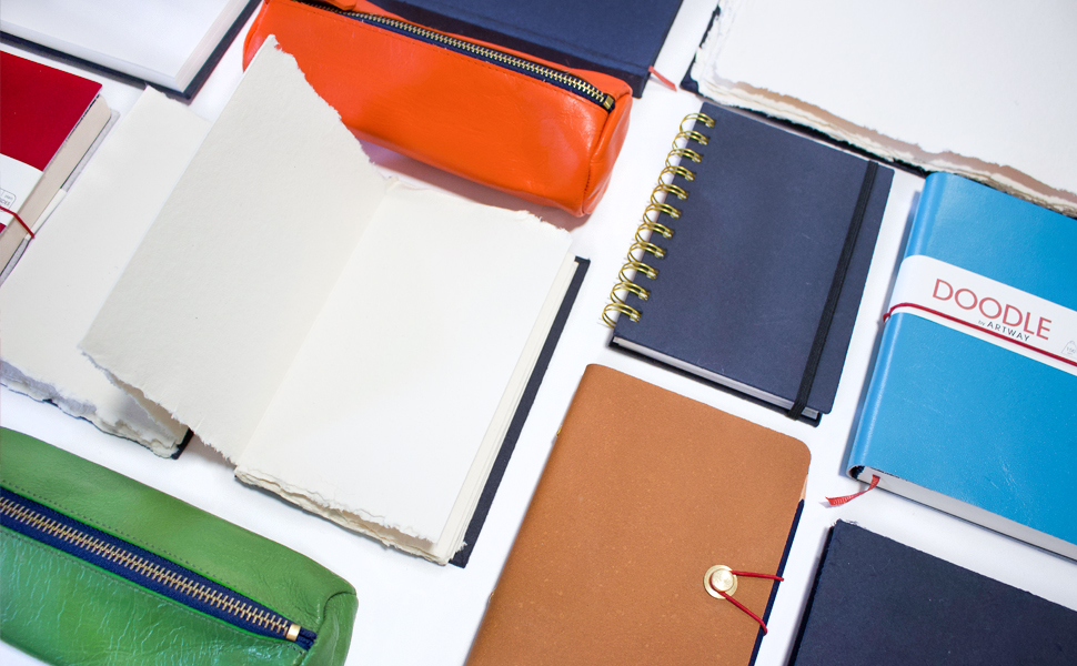 colourful leather journals and pencil cases. Fabric Covered sketchbooks