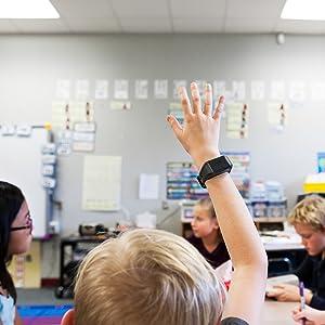 Boy raising hand with Revibe