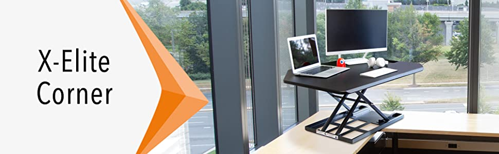 Stand Steady X-Elite Pro Corner Standing Desk Converter in an office.