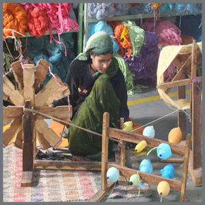 Handwoven, handcrafted, made with love, waste to gold. picture of a skilled artisan