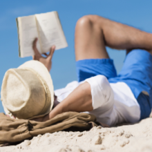 man Reads a Book at the Beach