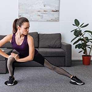 Woman doing lateral lunges at home with Limm core sliders