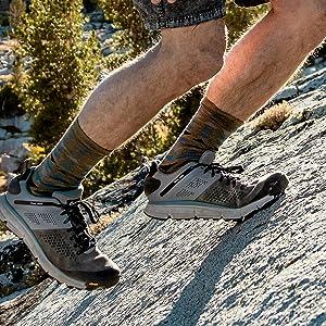 man climbing on steep trail