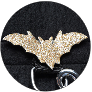 The gold bat of the Halloween dog bat wings.