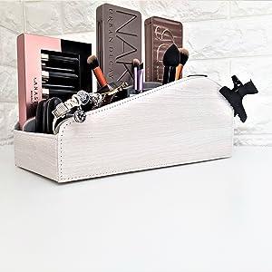 white makeup holder cosmetics holder makeup brush holder on table