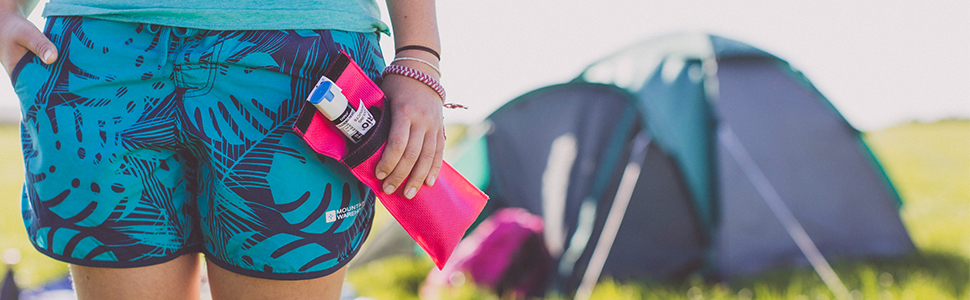 Image of Woman at Campsite holding a Frio DUO Wallet