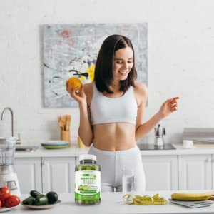Woman in Kitchen with Garcinia 3-in-1