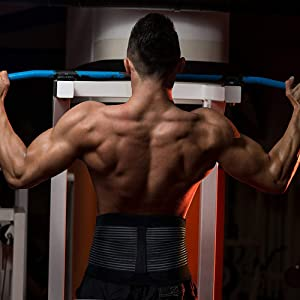 A male doing a pull up wearing the AllyFlex adjustable back brace