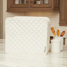 Cream appliance cover on kitchen counter