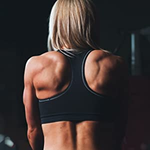 CLINICAL DAILY creatine supplement women working out lifting weights showing back lean muscle