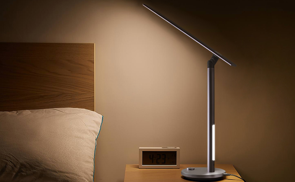 led desk lamp on bed table""