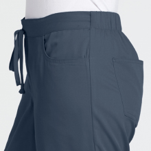 Front drawstring and curved front pockets and back patch pockets shown on Grey's Anatomy scrub pant