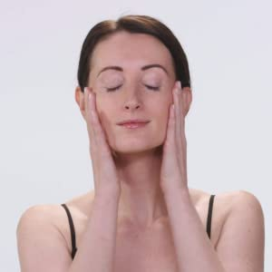 Woman Using The Baebody Retinol Moisturizer