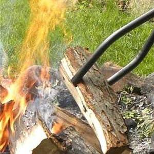 grabber holding log into fire