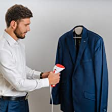 Man holding a steamer for clothes
