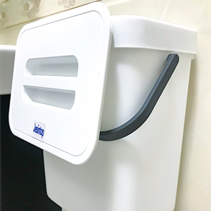 white small trash can with lid