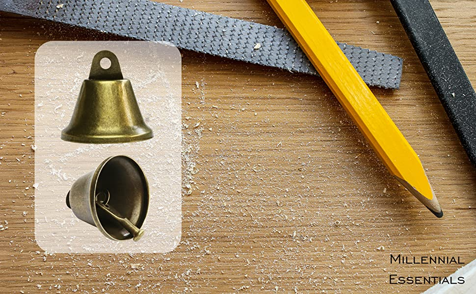 hero image vintage bronze jingle bells crafting housebreaking dog potty training Christmas bells
