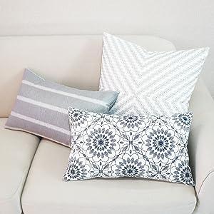 grey decoratice lumbar pillows 12x20