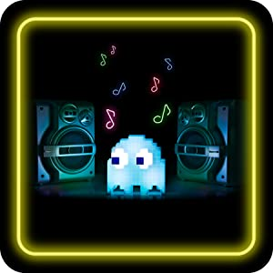 Pac-Man ghost light next to large speakers
