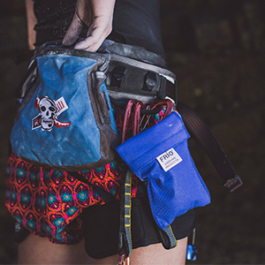Rock climber with FRIO wallet attached to belt