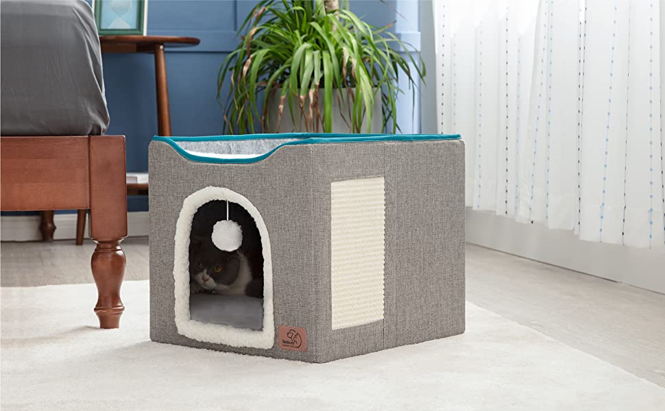 cat in the Bedsure Cat Cube, Foldable Cat Cubes for Indoor Cats, Cat House Indoor - Large Cat Bed with Fluffy Ball Hanging and Scratch Pad