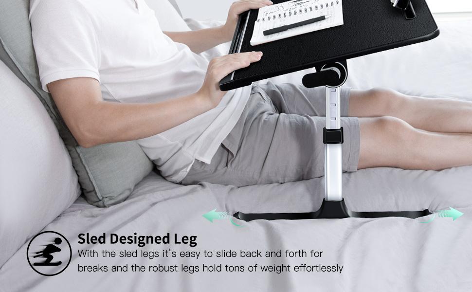 Sled design leg for easily sliding the laptop table on the bed