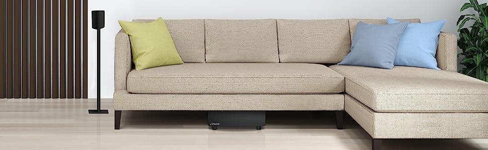 Milan subwoofer and satellite next to sofa