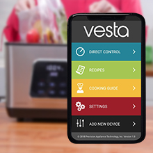smartphone with Vesta app in foreground Perfecta in background