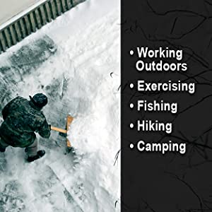 Man shoveling snow wearing hooded jacket. Photo is aerial perspective with blanket of snow below.