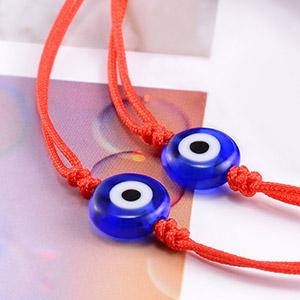 2 red string evil eye bracelets
