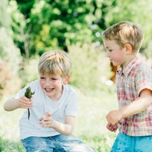 2 Boys catching a frog