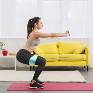 women workout at home with resistance bands