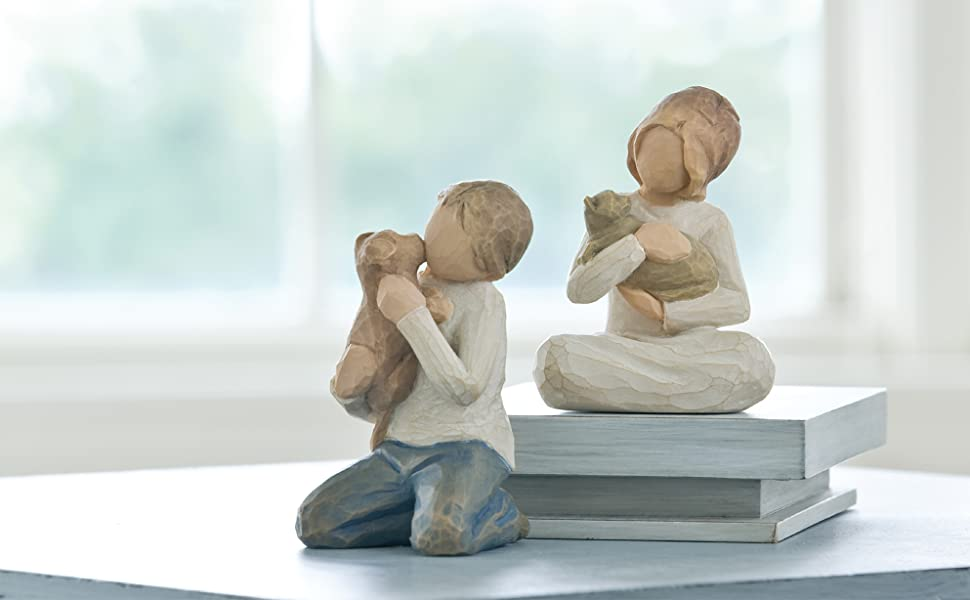 Group shot of Willow Tree Kindness girl and boy figures.