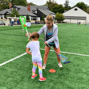 Girl with coach learning lacrosse face dodges using Swax Lax lacrosse training balls
