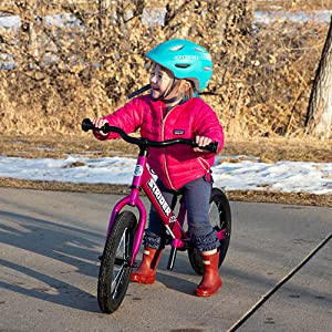 Young girl riding the Strider 14X Bike